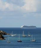Passenger ocean liner approaching island Royalty Free Stock Image