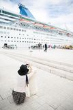 Passenger photographing big cruise ship Stock Photography