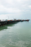 Passenger pier with many cars and boats Stock Photography