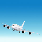 Passenger plane. Flying in the blue sky Royalty Free Stock Images