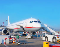 Passenger plane in the airport. Royalty Free Stock Images