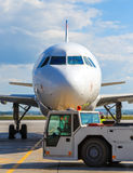 Passenger plane in airport summer sunny day. Aircraft maintenance. Stock Photos