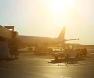 Passenger plane in the airport at sunrise. Royalty Free Stock Photos