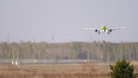 Plane approaching landing, hard haze distortion