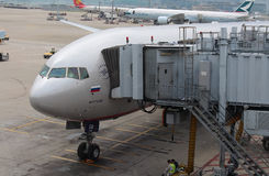 A passenger plane Boeing 777-300ER (named M.Kutuzov) of Aeroflot russian airlines in the Chek Lap Kok airport, Hong Kong. A new passenger plane from Moscow in Stock Photography