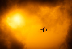 Passenger plane and dramatic sky Stock Photo