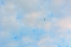 Passenger plane flies away Stock Photo
