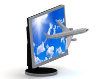 Passenger plane flies out of your computer screen Stock Photo