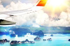 A passenger plane flies over a set of islands in Thailand, Phuket. Aerial view. From the airplane window royalty free stock photo