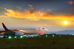 Passenger plane fly down over take-off runway from airport Royalty Free Stock Photos