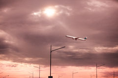 Passenger plane fly up over take-off runway from airport Royalty Free Stock Image