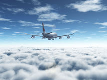 A passenger plane flying above the clouds stock photos