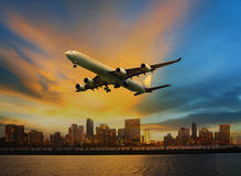 Passenger plane flying above urban scene use for convenience air Royalty Free Stock Image