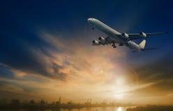 Passenger plane flying on beautiful dusky sky royalty free stock images