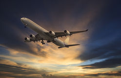 Passenger plane flying on beautiful  dusky sky Stock Photos