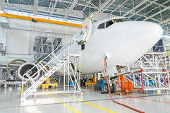 Passenger plane in the hangar. Stock Images