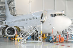 Passenger plane in the hangar. Royalty Free Stock Images