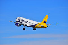 Passenger Plane Just After Take Off. A Monarch Airlines passenger aircraft climbs after take off from Alicante Airport on Spains Costa Blanca coast royalty free stock image