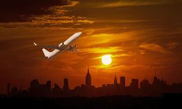 Passenger plane is landing during a airport NY wonderful sunrise. Passenger plane is landing during a airport New York wonderful sunrise stock image