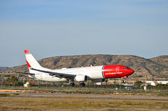 Passenger Plane Landing Stock Photo