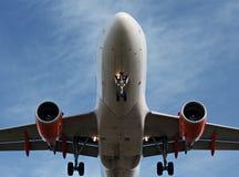 Passenger plane landing overhead Stock Photo