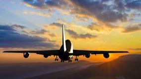Passenger plane is landing. During a wonderful sunrise royalty free stock images