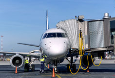 Passenger plane maintenance in airport before flight. Royalty Free Stock Image