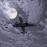 Passenger plane. Passenger plane in the night sky Stock Image