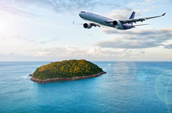 Passenger plane over tropical island Royalty Free Stock Photography