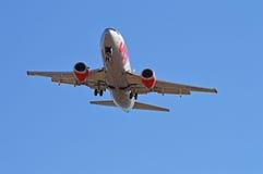 Passenger Plane Overhead Stock Photography