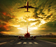 Passenger plane ready to take off on airport runways with urban Royalty Free Stock Images