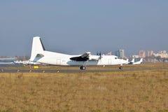 Passenger plane on runway Stock Image