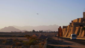 Passenger Plane in the Sky Landing on the Background of Mountains and Palm Trees in Egypt. EGYPT, SOUTH SINAI, SHARM EL SHEIKH, DECEMBER 3, 2016: Passenger stock footage