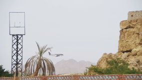 Passenger Plane in the Sky Landing on the Background of Mountains and Palm Trees in Egypt. EGYPT, SOUTH SINAI, SHARM EL SHEIKH, NOVEMBER 29, 2016: Passenger stock video footage