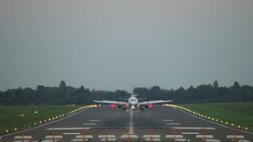 Passenger plane take-off from Hannover airport. HAJ at sunset stock video