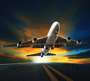 Passenger plane take off from runways against beautiful dusky sk Stock Photography