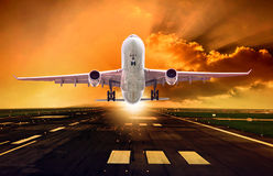 Passenger plane take off from runways against beautiful dusky sk Stock Images
