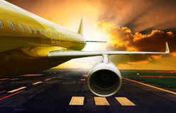 Passenger plane take off from runways against beautiful dusky sk Stock Photos
