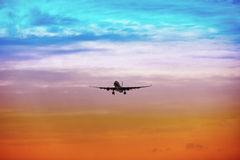 Passenger plane takes off at sunset Royalty Free Stock Photos