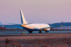 Passenger plane taxiing on the runway. In the early morning royalty free stock image