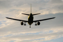 Passenger plane was landing Royalty Free Stock Photos