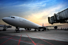 Passenger planes at the airport. In the evening Royalty Free Stock Photo