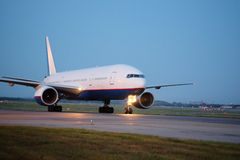 Passenger planes at the airport in the evening Royalty Free Stock Photography