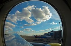 Passenger planes at the airport, view through window. Airplane view in airport terminal royalty free stock photo