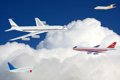 Passenger planes in the sky Stock Photography