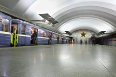 Passenger platform at a subway station, train with blue wagons. Royalty Free Stock Image