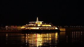 Passenger pleasure boat stands at the pier at night stock video