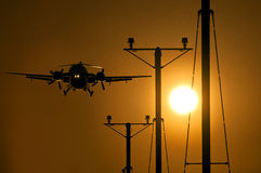 Passenger propeller plane approaching the runway at sunset. Passenger turbo propeller aircraft approaching the runway at sunset Stock Photography