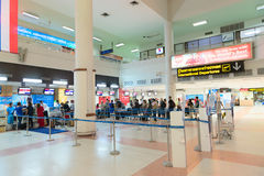 Passenger queue near check-in desks in airport Stock Photos