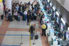 Passenger queue near check-in desks in airport Stock Photo